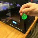 A finished 3-D Wilton Library keychain, as printed on the 3-D printer.