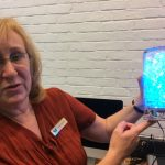 Susan Lauricella shows a light made with a programmed Arduino.