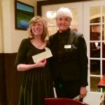 Pat Sesto accepts a $750 check from WGG's Jana Berktau for the Norwalk River Valley Trail.