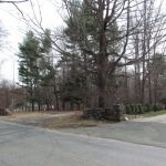 Looking across Honey Hill Rd. to the lot in question (toward the left). The neighboring residences can be seen on either side.
