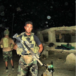 During Patenaude's last combat tour in Afghanistan. Before a night operation, with Harco.