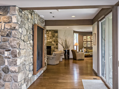 exposed stone and hardwood floors in the main house.