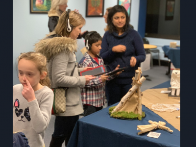 At the viewing of artifacts before the BOE meeting, guests listened to interactive presentations made by the students. photo:  Karen Brenneke/Twitter