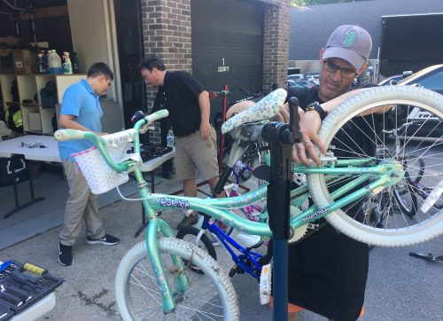 PHOTOS:  Wilton Volunteers Work Hard to Refurbish Bikes for Race for Chase Program