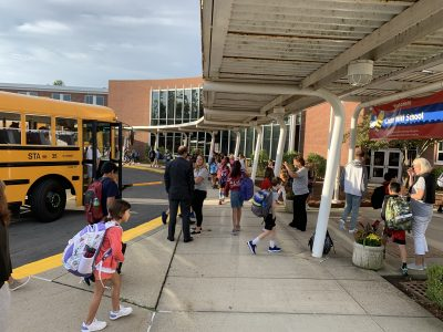 Superintendent Kevin Smith and principal Jen Falcone welcome students back to Cider Mill on the first day of the 2019-2020 school year.