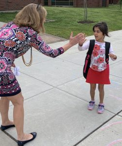Principal Kathy Coon always has a high five for a student.