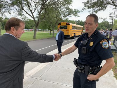 Superintendent Smith thanks Wilton Police Officer Joseph Calorossi for helping welcome all the Miller-Driscoll students.