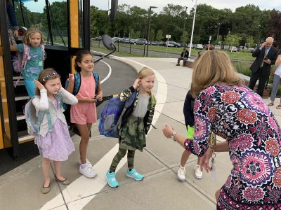 Even the bigger 1st and 2nd graders get a big hello and welcome back from Principal Coon.