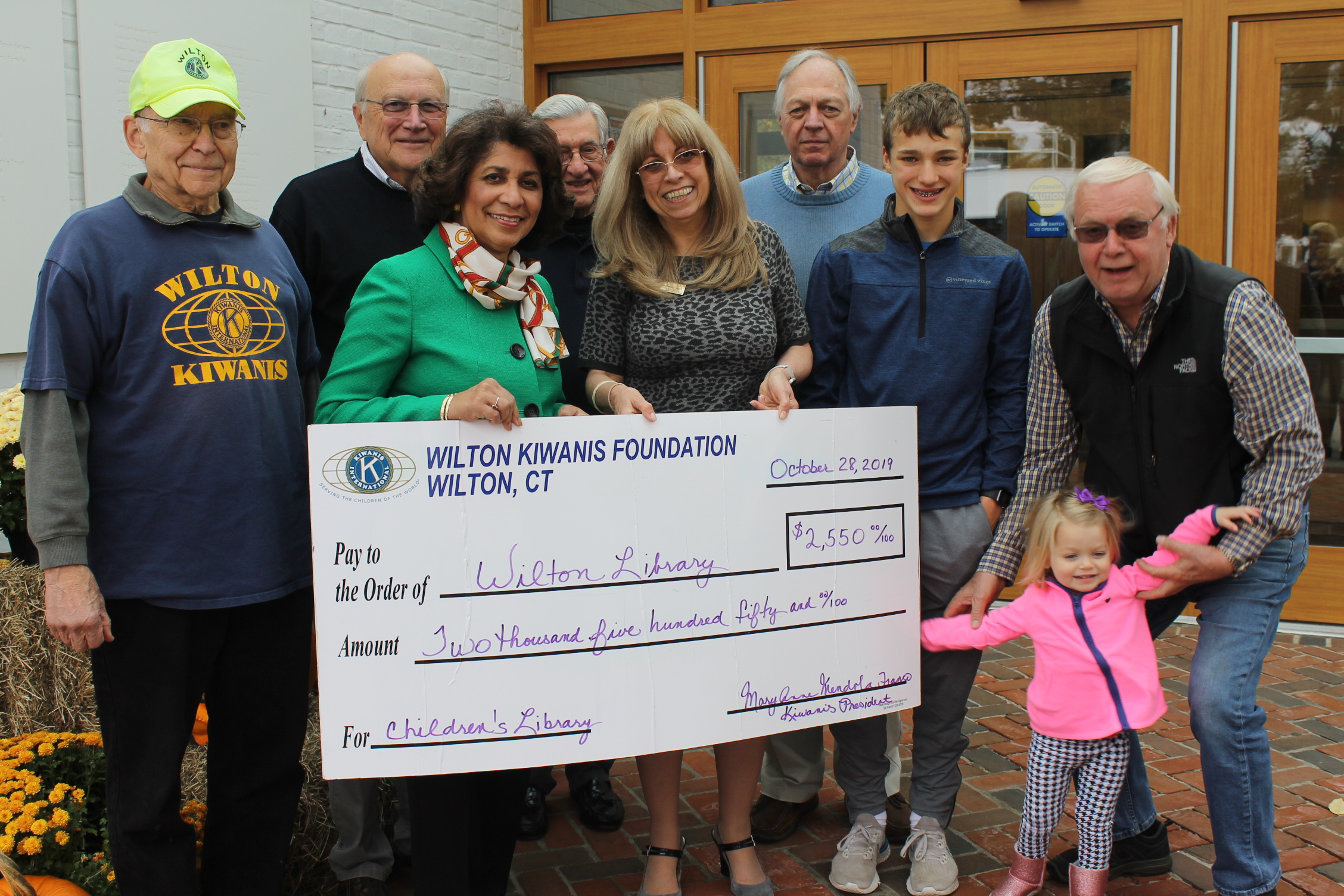 Wilton Kiwanis Club Gives Pumpkin Money Gift to Library